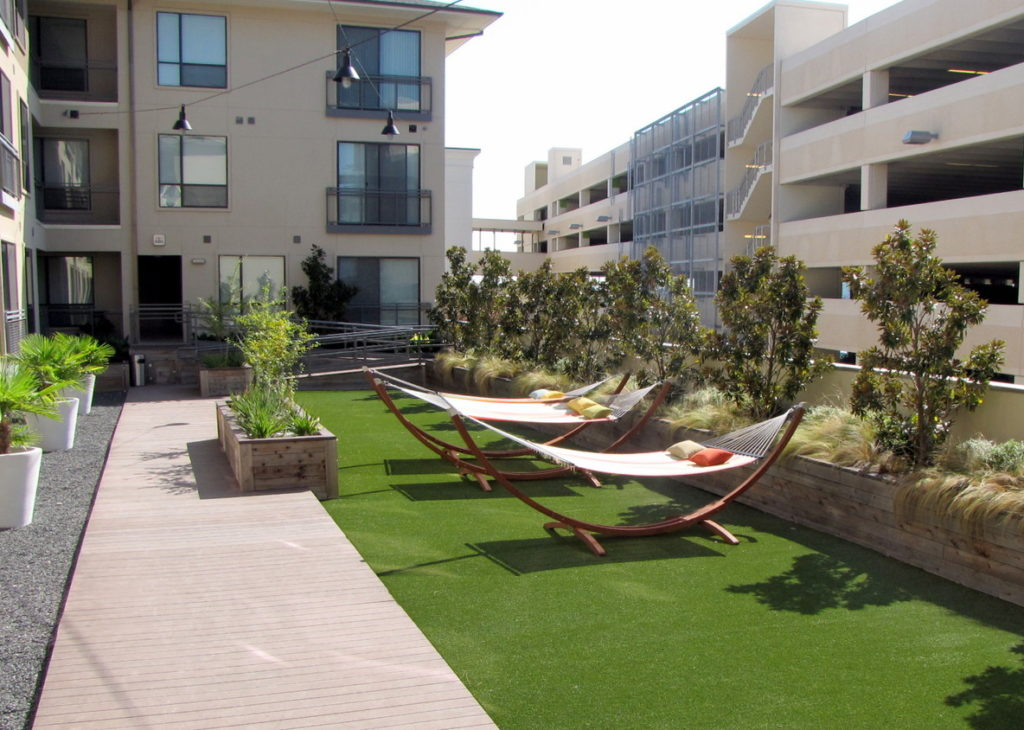 Relaxing outdoor hammocks at the Villages apartment at the Domain.
